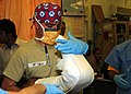 US Navy 100412-N-4614W-062 Hospital Corpsman 2nd Class Tommy Turtle, assigned to Navy Forward Surgical Team 4509, holds an improvised explosive device (IED) blast victim's broken leg.jpg