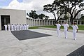 US Navy 100806-N-3005P-028 Capt. Rudy Lupton Command Master Chief Miguel-Juan Reyes salute during the national anthem at a remembrance ceremony at the Manila American Cemetery and Memorial.jpg