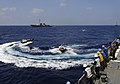 US Navy 110403-N-XX151-468 Sailors watch Indian sailors transport officers in rigid-hull inflatable boats as part of exercise Malabar 2011.jpg