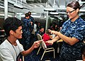 US Navy 110802-N-BK435-031 Hospital Corpsman 2nd Class Victoria Lord uses sign language to communicate with a child from the International Children.jpg