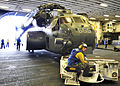 US Navy 110826-N-OY473-083 An MH-53E Sea Dragon helicopter assigned to Helicopter Mine Countermeasure Squadron (HM) 14 is moved into the hangar bay.jpg