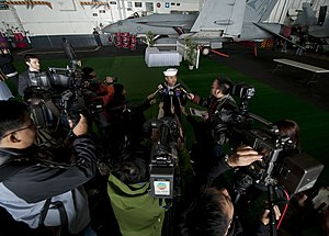 US Navy 111227-N-DR144-569 A Sailor speaks to members of the Hong Kong press..jpg