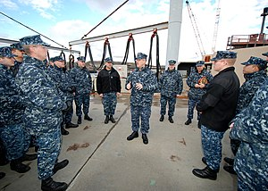US Navy 120113-N-AW342-005 Capt. Michael Holland, commodore of Submarine Squadron (SUBRON) 2, speaks to Sailors assigned to the Los Angeles-class a.jpg