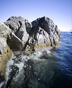 Weathering - Wave action and water chemistry lead to structural failure in exposed rocks