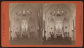 View of a garland-draped church interior with the pastor in the pulpit, by Ritton, E. D. (Edward D.) 2.png