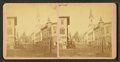 View of people standing on a commercial street, church visible in background, from Robert N. Dennis collection of stereoscopic views.png