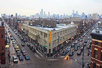 Wicker Park, Chicago - View of Milwaukee Avenue and North Avenue in Wicker Park, with the skyline of downtown, Chicago in the background
