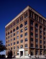 View of the Texas School Book Depository in Dallas, Texas, from which, according to the Warren Commission, Lee Harvey Oswald killed President John F. Kennedy in 1961 LCCN2011633319.tif