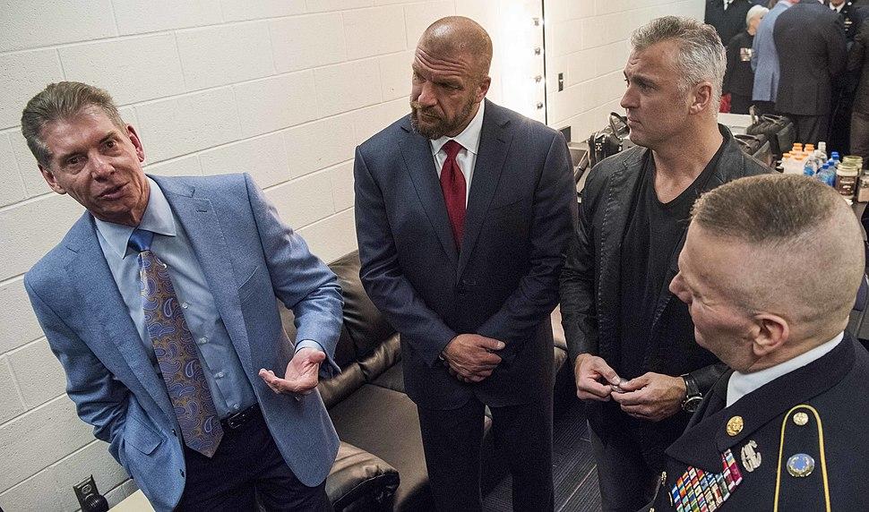 Vince McMahon, Triple H, Shane McMahon, John W. Troxell