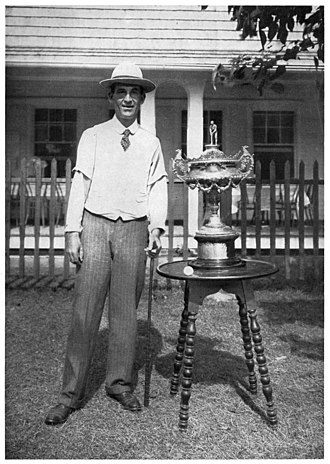 Walter Travis - Travis with 1901 U.S. Amateur trophy and rubber-cored ball