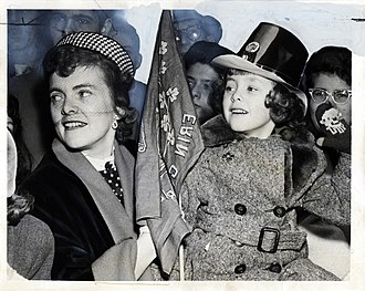 """Erin go bragh - Mother and child with an """"Erin Go Bragh"""" banner during a Saint Patrick's Day Parade in New York, 1951"""