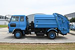 Waste collection truck(Hino Ranger) left side view at JASDF Miho Air Base May 27, 2018.jpg