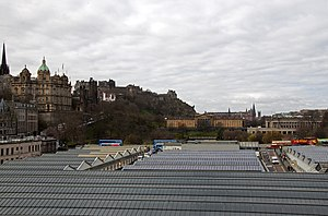 Waverley Bridge - Waverley Station roof and Waverley Bridge. The two ramps lead from the bridge into the station.