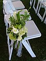 White and green floral aisle decor.jpg