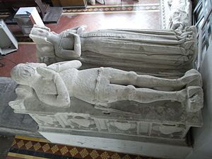 Manor of Shirwell - Willington effigies in their present location in Atherington Church, north side of chancel, on a 19th-century plinth. The Willington armorial saltire is still visible, much worn, on the knight's surcoat covering his chest