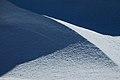 Wind-carved ridges of snow (6441670481).jpg