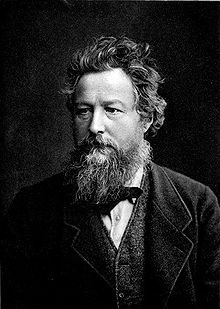 Photo portrait en noir et blance de William Morris, il porte une barbe