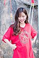 Woman in red t-shirt smiling and looking down.jpg