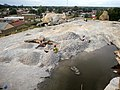 Women crushing stones using rudimentary methods - Soroti Uganda.jpg