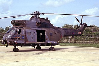No. 1563 Flight RAF - XW213 (CJ), a Puma HC.1 of 1563 Flt on the helicopter operating platform at Williamson Hangar, Philip S.W. Goldson International Airport on 13 August 1991