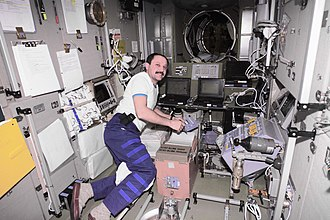 Yury Usachov - Yury Usachev, Expedition 2 commander, floats on board the Zvezda Service Module on the ISS.