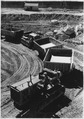 """""""Train of dump buggies waiting to be filled in foundation excavation."""" - NARA - 294134.tif"""