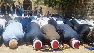 2017 Temple Mount shooting - Muslims praying at the entrance to the Temple Mount at the Tribal Gate, July 16, 2017
