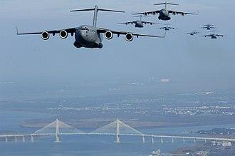 315th Airlift Wing - 315th Airlift Wing C-17 Globemaster IIIs over the Arthur Ravenel Bridge, Charleston, S.C.