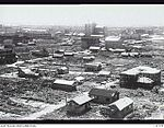 131779 REBUILDING NEAR THE RAILWAY STATION ONE YEAR AFTER THE ATOM BOMB WAS DROPPED.JPG
