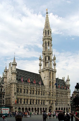 Grand Place - Brussels' Town Hall stands 96 metres (315 ft) tall and is capped by a 3-metre (12 ft) statue of Saint Michael slaying a demon.