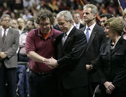 United States President George W. Bush with Virginia Tech Student Government Association President James Tyger after his speech at the school's convocation.