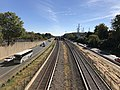 2018-10-25 11 33 23 View east along Interstate 66 (Custis Memorial Parkway) and the Orange and Silver lines of the Washington Metro from the overpass for eastbound Virginia State Route 237 (Washington Boulevard) in Arlington County, Virginia.jpg