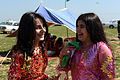 263827 A pair of girls giggle with one another during a Kurdish New Year celebration in the Qarah Anir region of Kirkuk, Iraq, March 21 in 2010.jpg