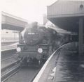82026 on station pilot duty at Waterloo 1965.jpg