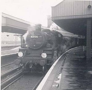 82026 on station pilot duty at Waterloo 1965.jpg