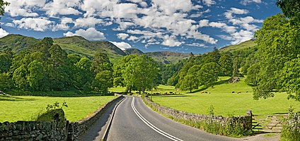 The A591 road as it passes through the countryside between Ambleside and Grasmere in the Lake District, England.