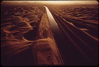 ALL-AMERICAN CANAL CARRIES COLORADO RIVER WATER THROUGH SAND-SWEPT AREA OF THE IMPERIAL VALLEY - NARA - 549076.jpg