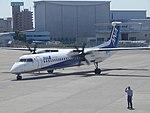ANA Wings Q400 JA859A at ITM (15502598604).jpg