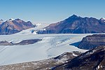 A Glacier Flowing Through a Section of the McMurdo Dry Valleys in Antarctica (30279240454).jpg