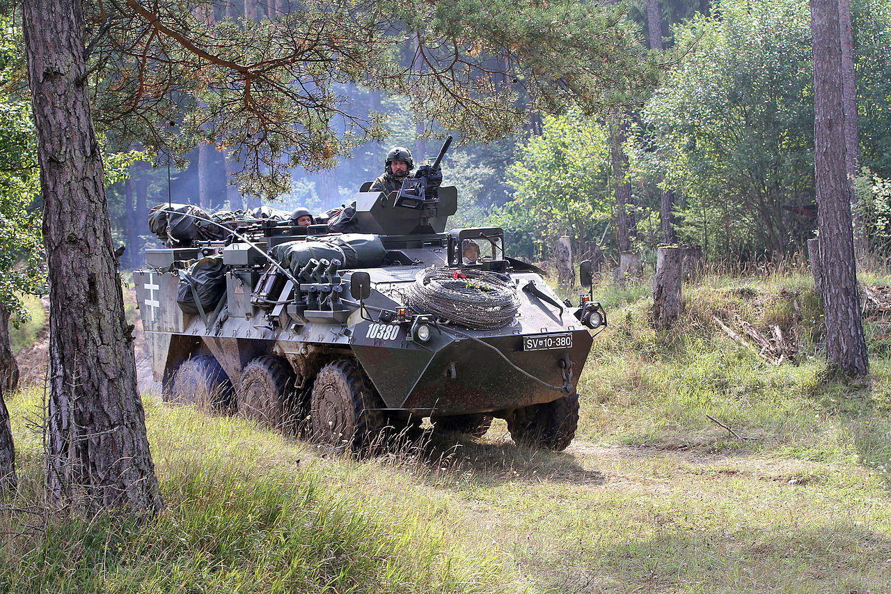 A Slovenian tank leaves its firing position at Hohenfels Training Area, Germany, Sept 140904-A-ZZ999-011.jpg