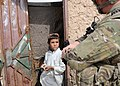 A U.S. Soldier speaks with a child during a foot patrol in the Maiwand district of Kandahar province, Afghanistan, Oct. 21, 2011 111021-A-ON828-002.jpg