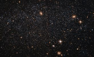 Leo A - Leo A is at a distance of about 2.5 million light-years, and is a member of the Local Group of galaxies.