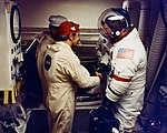 A closeout team member wishes Gene Cernan good luck as he prepares to enter the Command Module.jpg