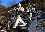 A five-man reconnaissance element of the Russian Army proceed by foot during a winter warfare training in a mountaineous terrain, Southern Military District.jpg