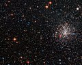 A globular cluster's striking red eye NGC 2108.jpg