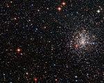 A globular cluster's striking red eye NGC 2108.jpg