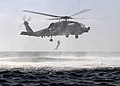 A search and rescue swimmer jumps from from an SH-60B Sea Hawk helicopter. (6852056749).jpg