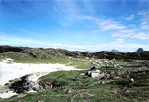 Achmelvich - Looking across Achmelvich beach towards Canisp and Suilven, showing the Machair as well as the Youth Hostel and Caravan Sites