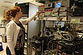 Adjusting a device in an optical communications system testbed.jpg