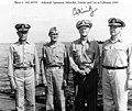 Admiral Raymond A. Spruance, Vice Admiral Marc Mitscher, Fleet Admiral Chester W. Nimitz and Vice Admiral Willis A. Lee aboard USS Indianapolis (CA-35), in February 1945 (NH 49705).jpg
